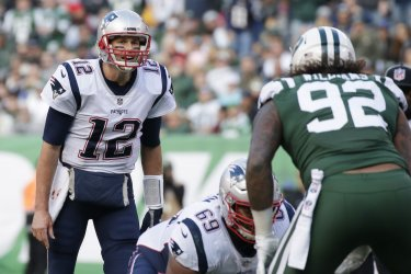 New England Patriots Tom Brady stands at the line