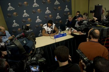 Members of the Baltimore Ravens speak to the press in New Orleans