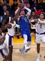 Dallas Mavericks Luka Doncic is fouled by Los Angeles Lakers Dwight Howard