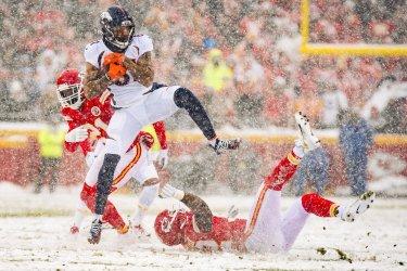 Broncos Tim Patrick is tackeld by Chiefs' Demone Harris  and Bashaud Breeland