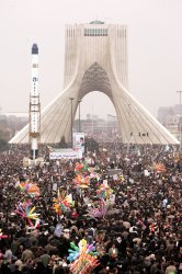Iranians attend a rally marking the 30th anniversary of Iran's Islamic Revolution in Tehran