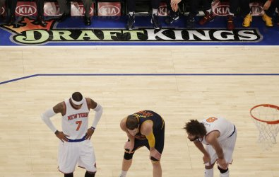 DraftKings logo on the basketball court