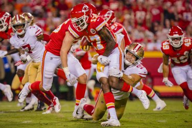 Chiefs Mecole Hardman is wrapped up by 49ers David Mayo