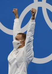 USA's Dressel celebrates Gold medal and Olympic record in Men's 50m Freestyle Final