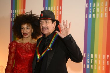 Rock guitarist Carlos Santana arrives for 2013 Kennedy Center Honors Gala in Washington DC