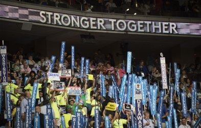 Delegates raise signs at the DNC convention in Philadelphia