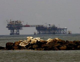 An oil platform seen from the beach at Port Fourchon, Louisiana