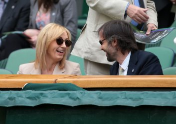 JK Rowling and her husband at 2013 Wimbledon Championships