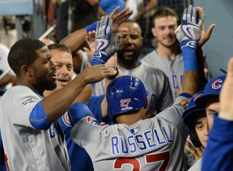 Cubs Russell high fives teammates after 2-run sixth inning home run against the Dodgers in the NLCS game five