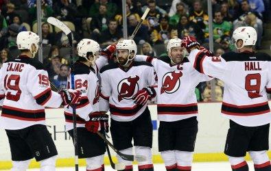 Devils Blandisi Celebrates Palmieri's Goal in Pittsburgh