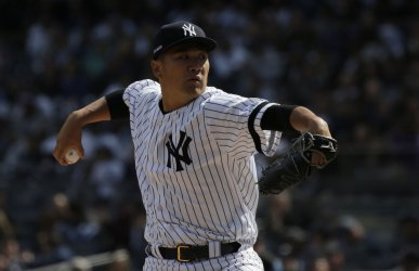 Yankees Masahiro Tanaka throws a pitch on Opening Day