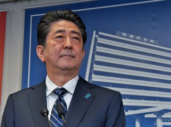 Abe holds a press conference after election win