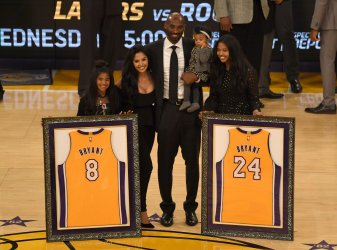 Lakers retire Kobe Bryant's 8 & 24 jerseys during half time ceremony in Los Angeles