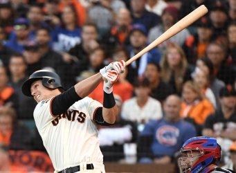 San Francisco Giants Buster Posey hits a sac fly