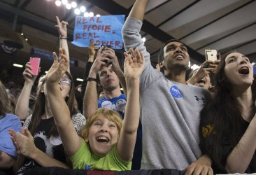Supporters cheer as Bernie Sanders speaks during a rally in Baltimore.