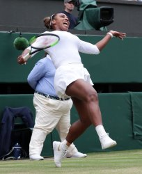 Serena Williams returns in her mixed doubles Second round match with Andy Murray at Wimbledon