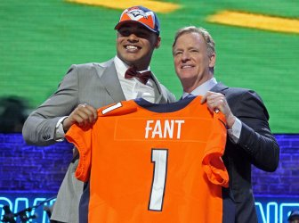 Noah Fant  from Iowa receives a jersey from NFL Commissioner Roger Goodell