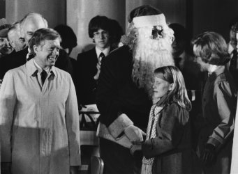 Jimmy Carter and family parrtially light the National Christmas Tree