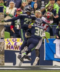 The Seahawks beat the Buccaneers 40-34 in overtime.  in Seattle