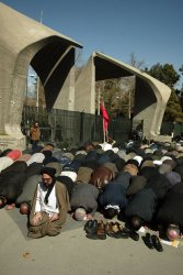 Iranians attend the funeral ceremony for 5 people killed during the 8-year Iran-Iraq war