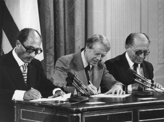 President Carter and Mid-East leaders Sign Negotiation Agreements.