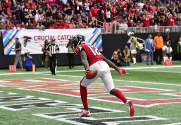 Falcons' Mohamed Sanu scores a touchdown during an NFL game in Atlanta