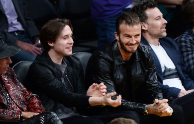 David and Brooklyn Beckham attend Kobe Bryant's final game as a Laker in Los Angeles