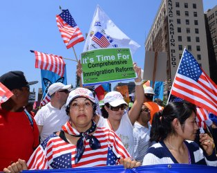 Thousands march and rally for immigration reform in Los Angeles