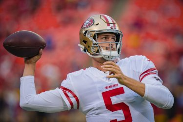 49ers Wilton Speight throws a pass during warmups