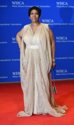 Aretha Franklin poses on the red carpet at the White House Correspondents' Association Dinner