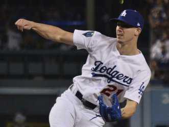 Dodgers starter Buehler throws during the seventh inning in Game 3 of the World Series
