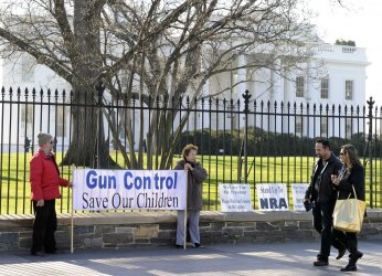 Gun control advocates hold vigil in front of White House in Washington DC in aftermath of Connecticut shootings
