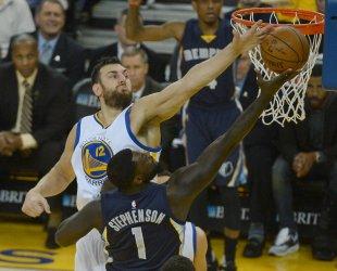 Warriors Andrew Bogut blocks a shot