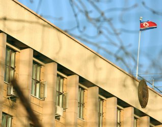 North Korean flag flies over its embassy in Beijing