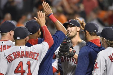 Boston pitcher Rick Porcello is congratulated after his 5-2 complete game win over Baltimore