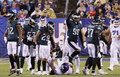 Eagles players react after they tackle Giants Saquon Barkley