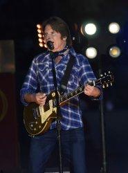 Rock performer John Fogerty sings in half time show at the Orange Bowl