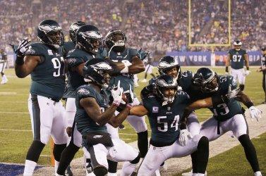 Philadelphia Eagles players celebrate an interception