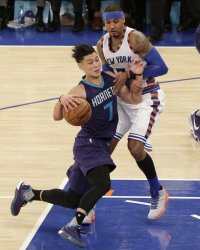 Hornets Jeremy Lin makes contact with Knicks Carmelo Anthony