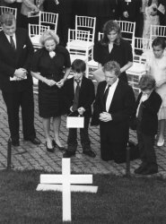 Edward Kennedy, Ethel Kennedy and other family members pay respect at the grave of Robert F. Kennedy