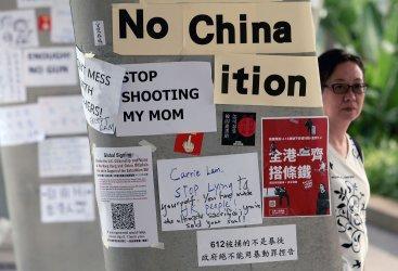 Protest signs still hang on walksways in Hong Kong