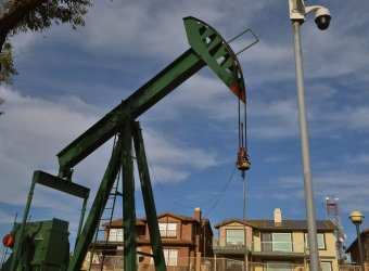 Oil wells and fields are integral presence in Signal Hill, California