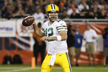 Packers quarterback Aaron Rodgers looks to pass the ball  in Chicago