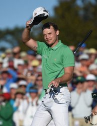 Danny Willett reacts on the 18th green at the Masters
