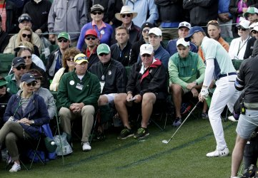 Jordan Spieth chips to the 18th green at the Masters