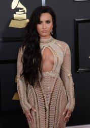 Demi Lovato arrives for the 59th annual Grammy Awards in Los Angeles