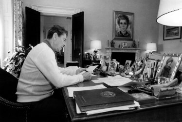 President Ronald Reagan works on his State of the Union address in his study.