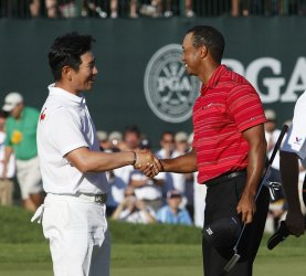 Y.E. Yang and Tiger Woods shake hands after the final round of the 91st PGA Championship in Chaska, Minnesota
