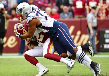 Redskins QB Colt McCoy sacked for loss by Patriots' Michael Bennett