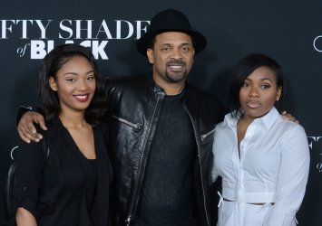 """Mike Epps and his daughters attend the """"Fifty Shades of Black"""" premiere in Los Angeles"""